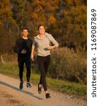 young  veautiful couple runs on ... | Shutterstock . vector #1169087869