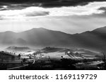 sunrays coming over a valley in ... | Shutterstock . vector #1169119729