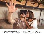 modern couple using vr glasses... | Shutterstock . vector #1169132239
