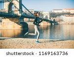woman in sportswear running on...   Shutterstock . vector #1169163736