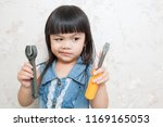 girl is playing a repairman... | Shutterstock . vector #1169165053