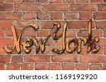 new york logo on brick wall... | Shutterstock . vector #1169192920