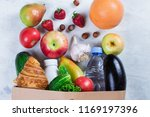 full grocery paper bag of... | Shutterstock . vector #1169197396
