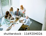 multiracial business people... | Shutterstock . vector #1169204026
