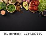 fresh green vegetables on black ... | Shutterstock . vector #1169207980