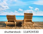 Two Beach Chairs On Wooden...