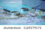 magnifying glass and compass on ... | Shutterstock . vector #1169279173