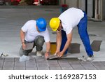 bricklayer at work in building... | Shutterstock . vector #1169287153