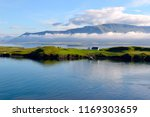 view of island with house in... | Shutterstock . vector #1169303659