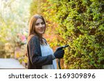 smiling young woman with garden ... | Shutterstock . vector #1169309896