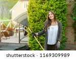smiling young woman with garden ... | Shutterstock . vector #1169309989