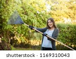 smiling young woman with garden ... | Shutterstock . vector #1169310043