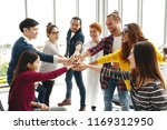 multiethnic young team stack... | Shutterstock . vector #1169312950