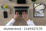 medical worker typing on laptop ... | Shutterstock . vector #1169327170