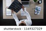 neurosurgeon looking at human... | Shutterstock . vector #1169327329