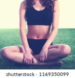 woman sitting with crossed legs ...   Shutterstock . vector #1169350099