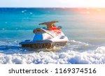 water motorcycle in blue sea on ... | Shutterstock . vector #1169374516