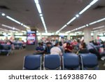 blur airport people sit waiting ... | Shutterstock . vector #1169388760
