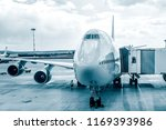 passenger plane in airport .... | Shutterstock . vector #1169393986