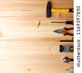 set of hand tools on wooden... | Shutterstock . vector #1169397850