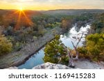 the sun sets over the greenbelt ... | Shutterstock . vector #1169415283
