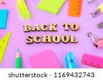 school supplies on violet... | Shutterstock . vector #1169432743
