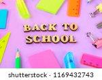 school supplies on violet... | Shutterstock . vector #1169432743