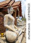 buddhas behind an outdoor wall... | Shutterstock . vector #1169460613