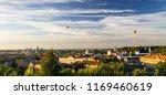 balloons flying over the city... | Shutterstock . vector #1169460619