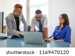 group of colleagues at laptop... | Shutterstock . vector #1169470120