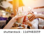 cheers group of women met with... | Shutterstock . vector #1169483059