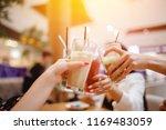 cheers group of women met with... | Shutterstock . vector #1169483059