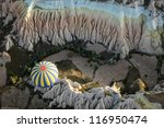 View of the air balloon flying over rock formation - stock photo