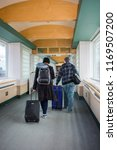 a young couple at the airport... | Shutterstock . vector #1169507200