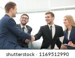 handshake of business people at ... | Shutterstock . vector #1169512990