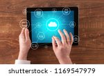 hand touching tablet with cloud ... | Shutterstock . vector #1169547979