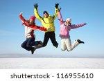 Three Friends Joyfully Jump...
