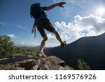 successful woman hiker walking... | Shutterstock . vector #1169576926