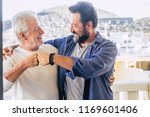 two happy male friends father... | Shutterstock . vector #1169601406