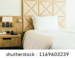 white comfortable pillow on bed ... | Shutterstock . vector #1169603239