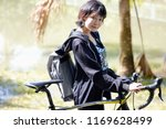portrait of an asian woman with ... | Shutterstock . vector #1169628499