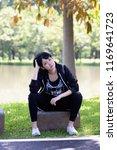 portrait of a beautiful asian... | Shutterstock . vector #1169641723