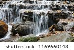 natutal waterfall in forest | Shutterstock . vector #1169660143