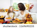 mother and daughter cutting... | Shutterstock . vector #1169690233