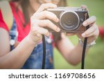 asian women holding vintage... | Shutterstock . vector #1169708656