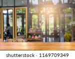 brown wooden at cafe blurred... | Shutterstock . vector #1169709349