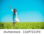 freedom concept. young happy... | Shutterstock . vector #1169721193