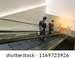 blur people in escalator in... | Shutterstock . vector #1169723926