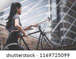 sport woman is carrying her... | Shutterstock . vector #1169725099