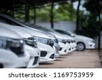 cars for sale stock lot row.... | Shutterstock . vector #1169753959